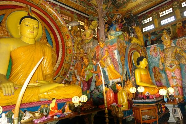 Seated Buddhas in a multi-religious temple in Colombo, Sri Lanka