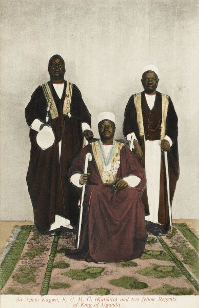 Card 2 of 2. The three Regents of the young King Daudi Cwa II of Uganda. They are: Sir Apolo Kagwa, KCMG (seated) and two fellow Regents. Sir Daudi Cwa II, KCMG, KBE (1896 - 1939) was the King (kabaka) of Buganda from 1897 to 1939. On 14 August 1897