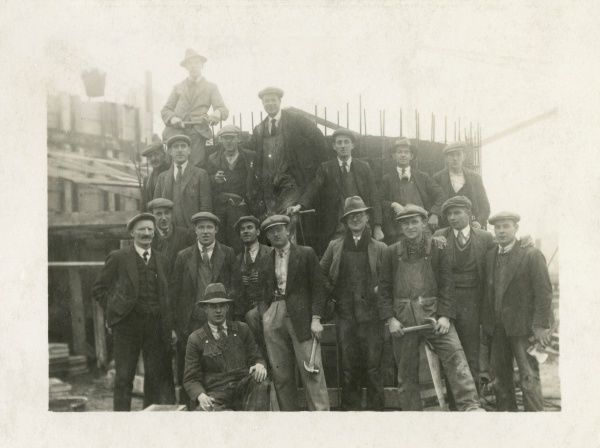 An informal group photo of some of the men who helped to build the Dorchester Hotel, Park Lane, London W1. Date: circa 1930