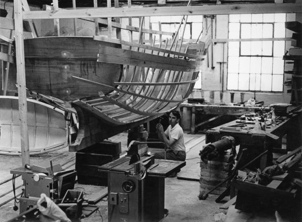 Andrew Besley, boat builder, building a 20 foot traditional wooden fishing boat at St Ives, Cornwall. It is designed to work off a steep pebble beach of the kind found in East Devon. It was built to order, with an oak keel and steamed oak ribs