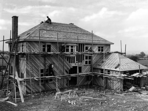 "An ""all timber"" private detached house being constructed in the open countryside. Date: 1930s"