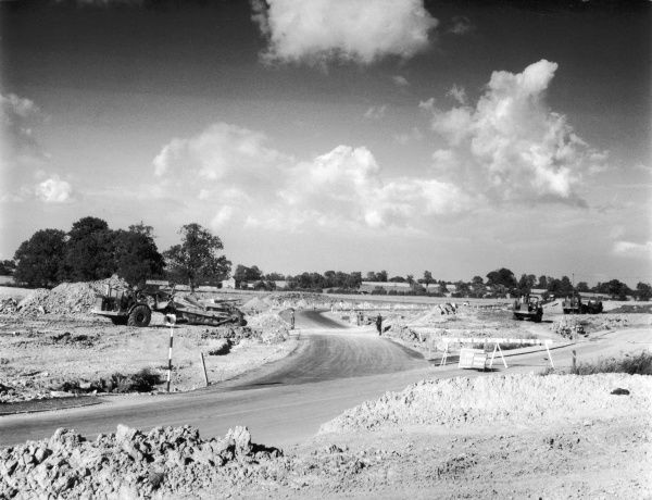 Building the M1 Motorway. Our photograph shows a section under construction at Upper Heyford, Northamptonshire, England. The Southern stretch opened 2 November 1959