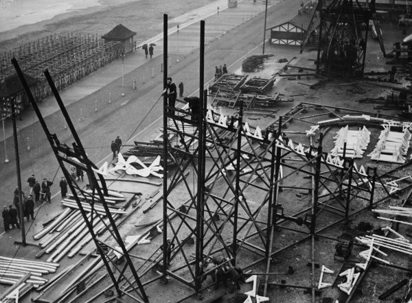 Huge scaffolding erected for the construction of a rollercoaster, part of the 'Merrie England' funfair at Ramsgate, Kent, England.  early 1930s