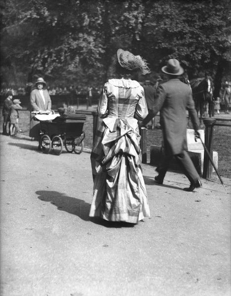 Even in 1931, a lady wearing a Victorian bustle could still turn heads in Hyde Park, London, England