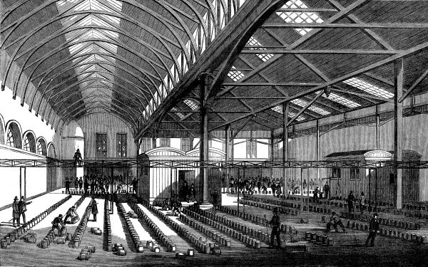 Engraving showing the interior of the Butter Market at Cork, Ireland, 1859. The image shows a large number of barrels of butter being moved by market porters