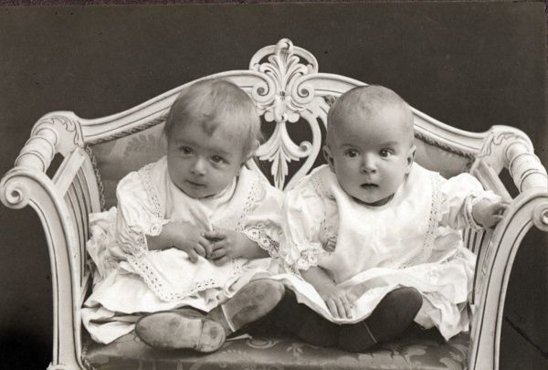 Twins in a small sofa, Date: C. 1910