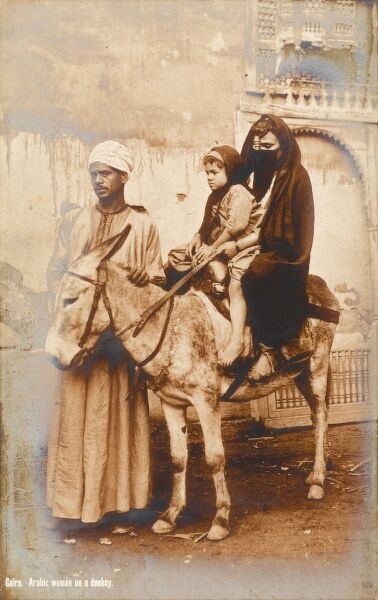 Cairo, Egypt. A beautiful postcard depicting a woman and her child sitting on a donkey (being led by her husband)