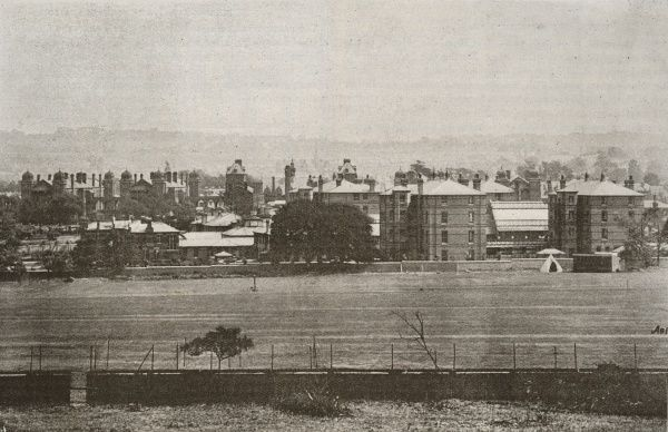 Distant view of Camberwell workhouse, opened in 1895 on Constance Road, East Dulwich, south London. The onion domed tops of St Saviour's workhouse infirmary are visible to the rear. The Camberwell workhouse was designed by Thomas Aldwinckle
