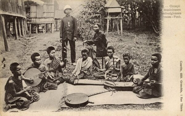 Cambodia - Traditional musicians at Phnom Penh. Instruments pictured include the tro khmer (played with a bow), hand cymbals, Khhim (flat Zither-like instrument) and Ruan (small round guitar/lute). Date: circa 1902