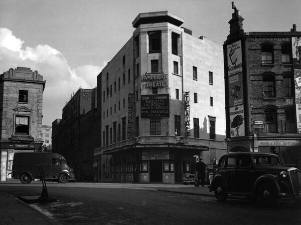 Cambridge Theatre at Seven Dials, London. The New London Opera Company is performing, presenting Don Giovanni, Rigoletto, La Boheme, The Barber of Seville, Don Pasquale and Tosca. Date: 1947