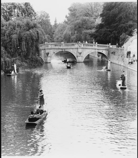 Male and female students punting at Cambridge on the river Cam