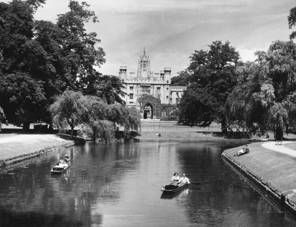 A glimpse of the beautiful Backs, and punters enjoying the River Cam, with St. John's College, Cambridge University, peeping through the trees