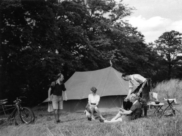 Convivial campers passing the time of day on a campsite at Tyler's Causeway, Hertfordshire, England. Date: 1930s