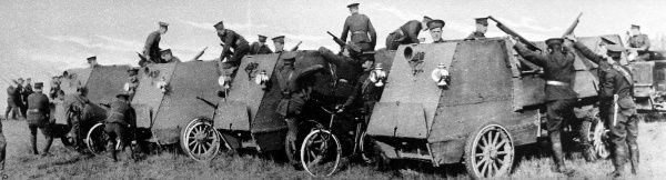 Canadian soldiers inspecting armoured cars at the Salisbury Plain camp