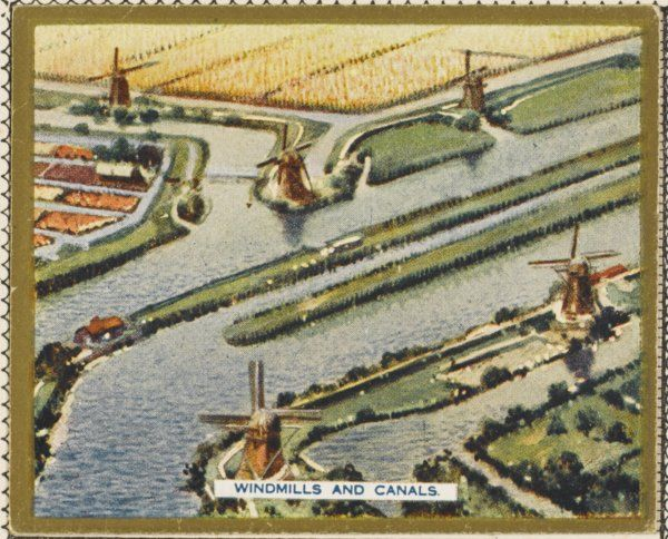 Aerial view of canals and windmills characteristic of the Dutch landscape