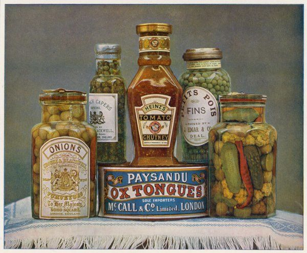 Bottled foods - onions, capers, chutney, petits pois and gherkins - and a can of Paysandu Ox Tongues, neatly arranged on a table