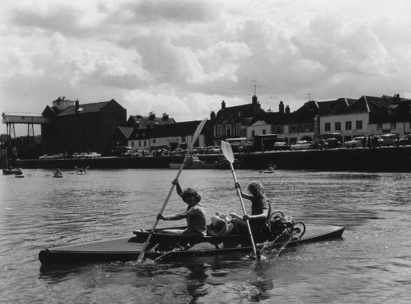 Two girls canoe during a school camp at Wells, Somerset. Date: 1960s