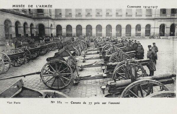 Captured German First World War artillery on display at the Museum de L'Armee at Les Invalides in Paris, France. As the card date states - these were the German guns captured between 1914-1917