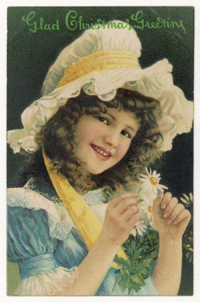 Smiling girl with daisies