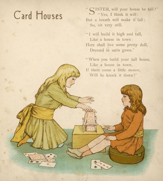 Two children build a card house
