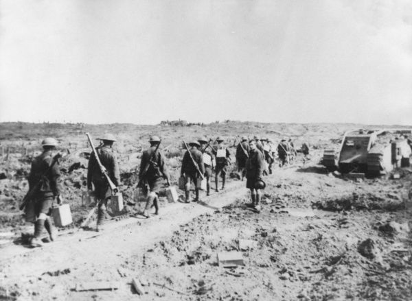 British soldiers carrying water in cans to the men on the front line, on the Western Front during the First World War. Date: 1916