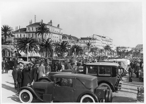 Concours d'elegance on the promenade at Cannes, France - crowds discuss the finer points of automotive carriage work