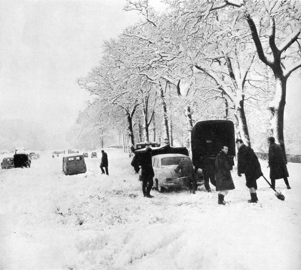 A long line of cars stranded at Pease Pottage Hill on the London to Brighton road in deep snow during the ferocious winter of 1963