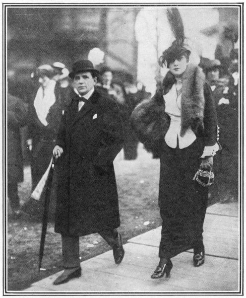 "The cartoonist and caricaturist, Georges Goursat, otherwise known as ""Sem"", (1863 - 1934), pictured at the races at Auteuil with Madame Roxane"