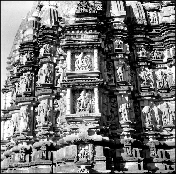 The ornate carvings on the walls of the Khajuraho Temples, Khajuraho, Madhya Pradesh Province, India. Photograph by Ralph Ponsonby Watts