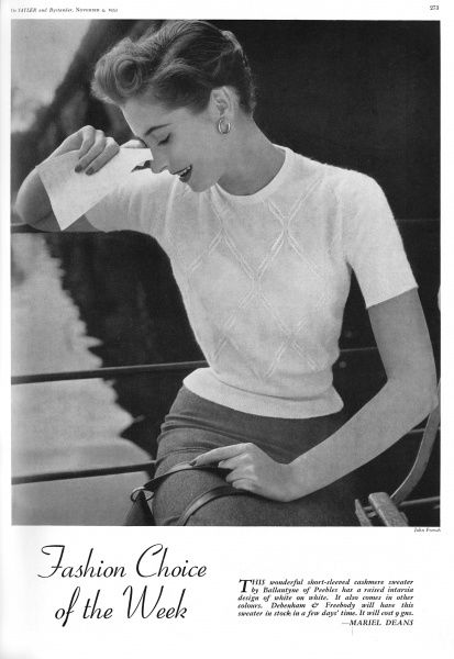 A short-sleeved cashmere sweater by Ballantyne of Peebles with a raised intarsia design of white on white. Date: 1953