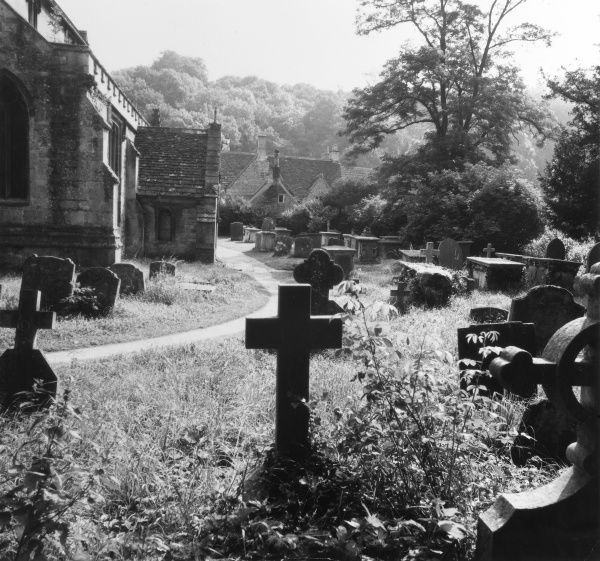 Part of the large churchyard of St. Andrew's Church, Castle Combe, Wiltshire, England, founded in the 13th century but largely rebuilt in the 19th century. Date: late 1960s