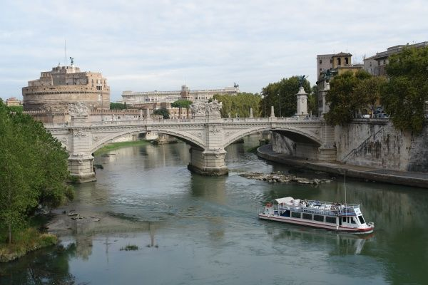 View of the River Tiber in Rome, Italy, at the Vittorio Emanuele II Bridge, with the Castel Sant'Angelo (sometimes also known as the Mausoleum of Hadrian) on the left