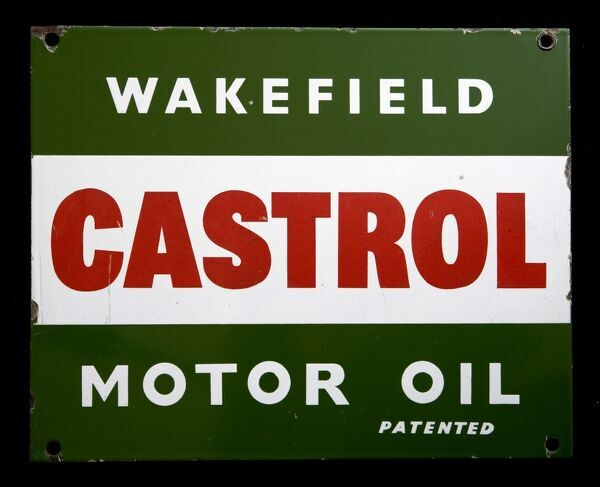 An enamel sign advertising Castrol Motor Oil from Wakefield. *EDITORIAL USE ONLY*