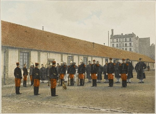 French cavalrymen and stablemen are inspected at their morning parade