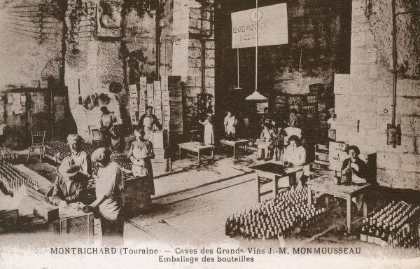 Labelling fine sparkling wine in the Wine Cellars of J M Monmousseau at Montrichard, Touraine Region Date: circa 1910s