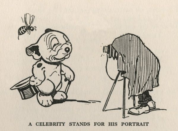 Bonzo, the famous canine cartoon character created by artist George Studdy in the 1920s poses for his photograph, unaware of a predetory wasp hovering above