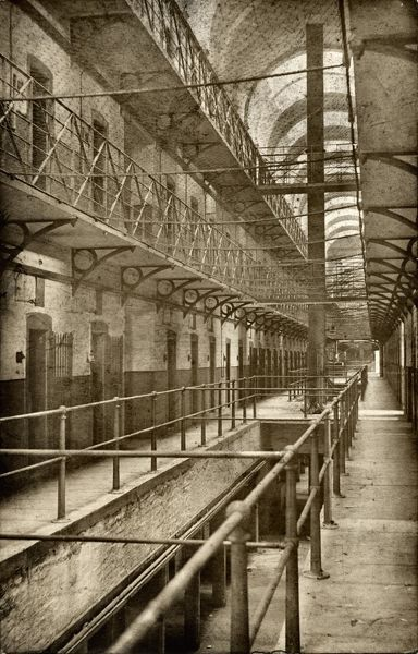 The interior of a cell block at Wakefield Prison, West Yorkshire. Cells line the open galleries which have a safety net strung across to prevent inmates falling. The prison was originally built as a House of Correction in 1594