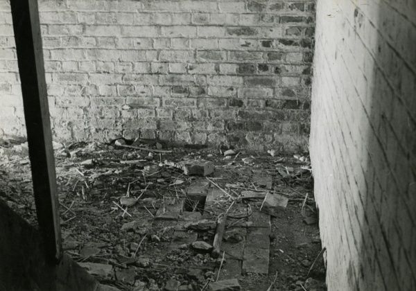Photograph of corner of the cellar in Borley Rectory where human remains were dug up. The photograph, taken on 28 March 1939, shows the aftermath of the fire of 27 February 1939. HPG/1/3/5 (xxxiii)