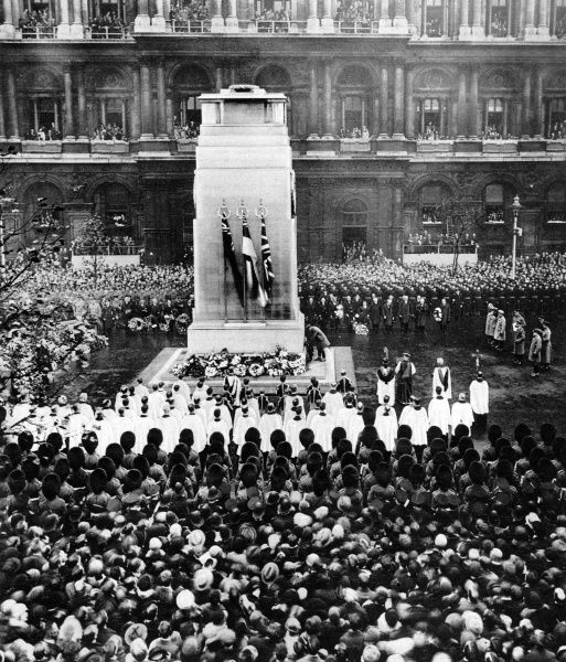 The tenth anniversary of the Armistice, the King laying his wreath at the base of the Cenotaph. The group to the right, behind the King are the Duke of York and the Prince Arthur of Connaught and the Indian Princes