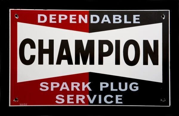 Enamel sign advertising Champion 'Dependable Spark Plug Service'. *EDITORIAL USE ONLY*