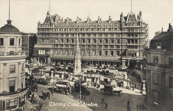 A pigeon's view of the Strand front of the station : most of the traffic is motorised now, the horse buses and hansom cabs are gone but horse drawn carts and wagons remain
