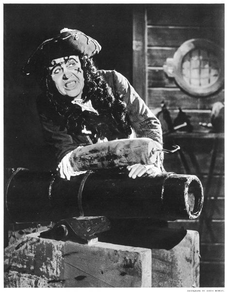 Charles Laughton playing Captain Hook in Peter Pan at the London Palladium. Elsa Lanchester, his wife, was Peter