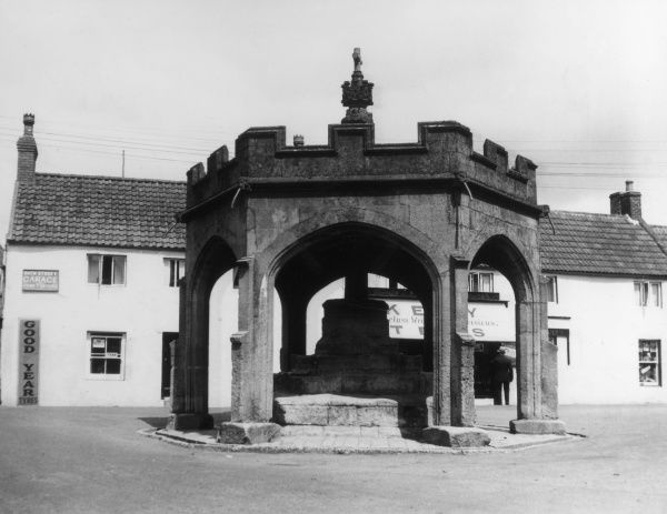 The 15th century Market Cross, Bath Street, Cheddar, Somerset, England. The shelter was rebuilt in 1834. Date: 15th century