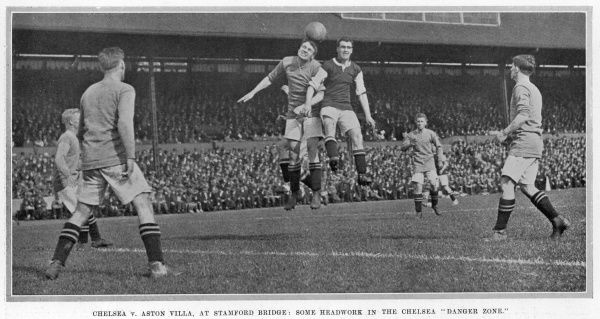 A footballer takes a header during the Chelsea v. Aston Villa match at Stamford Bridge, London