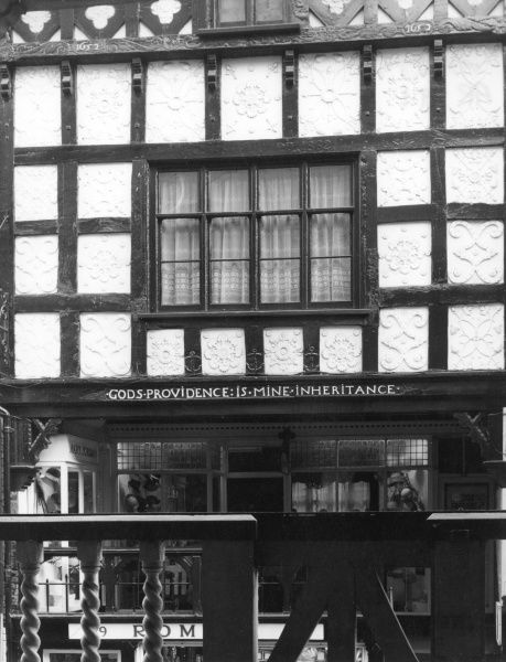 'God's Providence is Mine Inheritance' - one of the decorated black and white timber-framed Tudor fronts of the Rows, Chester, England. Date: 15th century