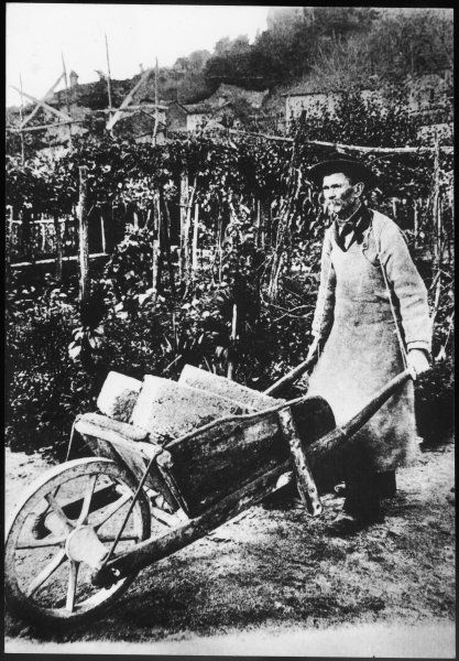 FERDINAND CHEVAL Rural postman and fantastic architect with his trusty wheelbarrow transporting rocks to build his 'Palais Ideal&#39