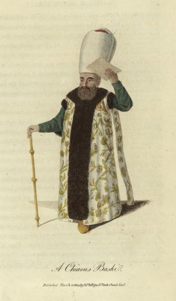A Chiaous Bashi, an official of the Sublime Porte. He was in charge of the court messengers and announced those wishing an audience with the Sultan, amongst other duties and responsibilities. He wears rich and elaborate robes, a high white turban