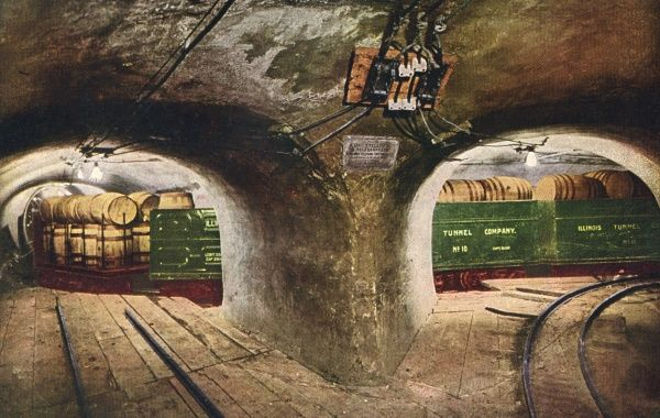 Beneath the streets of Chicago an extensive system of tunnels conveys freight hither and thither. Date: 1916
