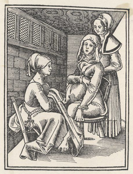 A midwife discreetly helps to deliver a child, while a friend supports the mother who is seated upright