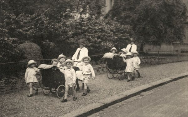 Children from the Alexandra Orphanage on Maitland Park Road, Haverstock Hill, North London. They are taking a walk with two prams being pushed by their carers